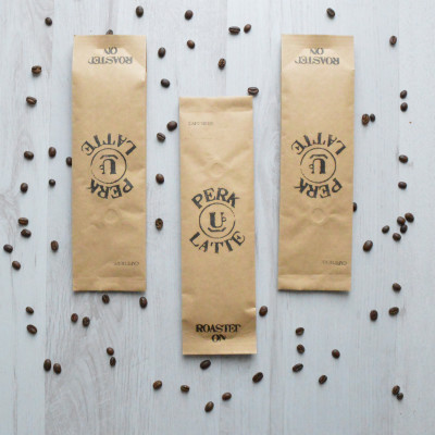 Three sample bags of single origin coffee, freshly roasted and ground in the UK.